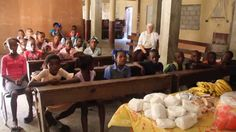 The children from Haitian Homes for Haitian Children (www.hh4hc.org) give thanks before lunch, from Jeremie, Haiti. Your sponsorship can make a difference.