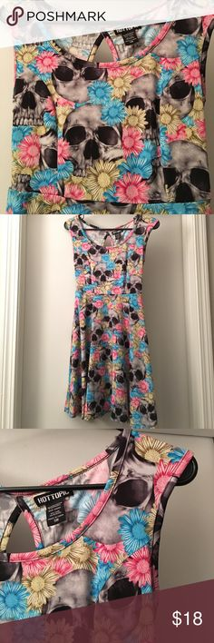NWOT Hot Topic Skull Floral Skater Dress never been worn. skater dress wih key hole in the back. skull print with pink, blue and yellow flowers. perfect condition - size small Hot Topic Dresses