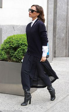 Super smart: Victoria embraced a preppy vibe, wearing her jumper buttoned up and layered over a crisp white shirt