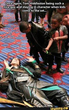 Not Tom Hiddleston... This is probably at a convention, but the guy who cosplays as Loki is indeed amazing!