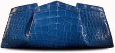 "Gabriella Wimmer introduces her classic luxe ""Duchess"" clutch in shiny blue Marine Alligator, ""Diamond Skin"" with 10 white diamonds accenting the crown and palladium metal work."