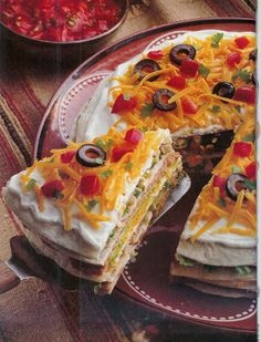 "Taco Pie 2 c. chicken or beef cooked & shredded 1 c. lettuce 4oz. can diced green chili's drained 2 Tbs. cilantro 8-10 "" tortillas 6 oz. avocado dip 16 oz. can refried beans 1 c. sour cream 1 1/2 c. cheese 1/4 c chop tomatoes 2 Tbs. sliced ripe olives 2 Tbs. cilantro Put tortilla on plate. Add 1/2 avocado. 2nd tortilla. Add 1/2 beans. 3rd tortilla. Add 1/2 meat-lettuce. 4th tortilla. Add 1/2 sour cream, add 1/2 cheese. Repeat layers end with sour cream, cheese, tomatoes, olives, cilantro…"