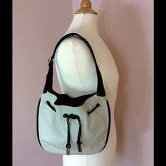 """Auth Gucci bone white black shoulder drawstring! SELLER NOTES: There are 2 of these items in my closet one in black and one in bone white w black trim please refer  Exterior Condition: (AB bone white and black bag ) / (B-) unnoticeable stitch repair  Exterior Pockets: n/a   Handles: (AB) 1 zip  Metal Hardware: (AB) some minor scratches black bag / minor scratches bone white bag  Odor: material  Interior Condition: lining (AB)   Interior Pockets: n/a  Height: 8"""" / 20.32 cm  Width: 12"""" / 30.48…"""