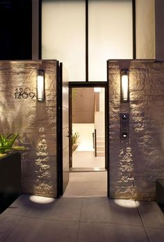 Minimalist house entrance with contemporary stone wall