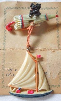 vintage PLASTIC DANGLE BROOCH~Scottie Dog riding Umbrella w/ sailboat