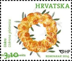 Pinca ( sirnica or pinza). Dalmatian braded bread. Easter tradition cake on postage stamp from Republic of Croatia (Hrvatska ) 2014 .