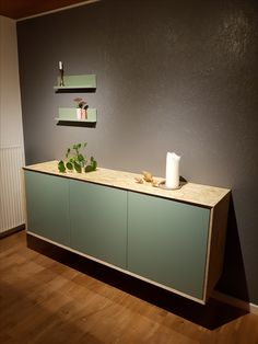 IKEA costum BESTÅ sideboard. It's made with BESTÅ, SELSVIKEN grey-green and OSB plate. I gave it bevelled joints and edges (30 degrees) all around to make it look more unique. I love it.