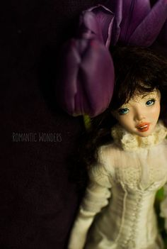 Lady is movable polymerclay doll. Two wigs Unremovable silk shirt, corset.