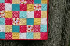 Love this fabric color combo with the turquoise, orangish-yellow, red, and pink.    Patchwork Pips by Fresh Lemons : Faith, via Flickr