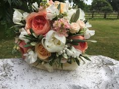 Flowers By Becca Jane created this bridal bouquet with gorgeous peaches, ivories and soft pinks.