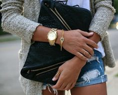 LAURA- gold watch. Michael kors makes great ones n TJ. Often has them!!