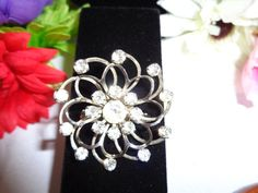 """Rhinestone Vintage Brooch that measures 1.5"""" with Matching Earrings for sale on site as well. Visit www.CCCsVintageJewelry.com and the earrings are missing one stone. Happy Holidays to you and yours. Our Holiday Sale which includes free shipping for items that add up to over $50.00 is in effect until the end of the year. Email me and I will adjust any prices I have to so that you get free shipping on your items. They will be sent out First Class Mail via USPS. And please visit our blog just…"""