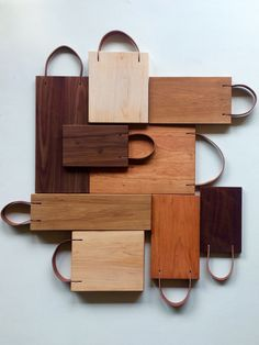 The Franklin Boards - Our latest collection of cutting boards with leather strap handles .