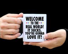 MUG INFO<---<< WELCOME TO THE REAL WORLD! IT SUCKS. YOURE GOING TO LOVE IT! (FRIENDS TV SHOW)  ♥Each mug is an 11-oz white ceramic coffee mug