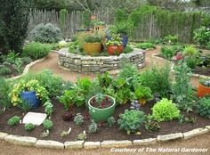 I like the idea of a round centerpiece framed with walkways and seperate beds.