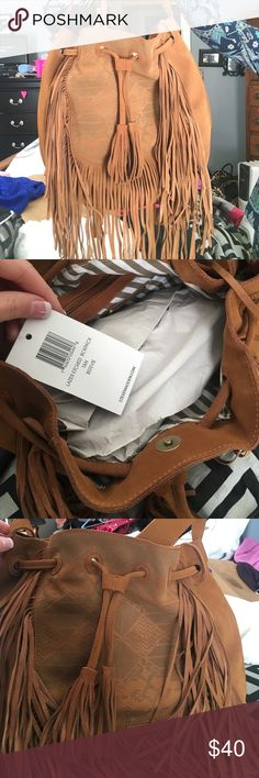 NWT Steve Madden fringe purse Aztec print. Paper hasn't even been taken out of the bag. It was a gift and I don't need anymore bags! Has a strap to be used as a shoulder bag, or straps for a backpack. Nordstrom has it for $108 Steve Madden Bags Shoulder Bags