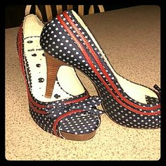 Navy Blue Pin-up Peep Toe Heels - polka dots Sexy, cute, fun all rolled into one pair of heels. Navy polka dots peep toes with Bows on the toes and red ribbon trim. Never been worn outside of the house. Inside soles have some markings from storage. So cute!! Brand is Not Rated, size 10 Not Rated Shoes Heels
