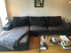 this dark grey black l shaped couch is comfortable and in good condition