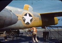 Spray painting of a B-25 Mitchell from the 17th Reconnaissance Squadron at Lingayen Airfield, the Philippines, 1945