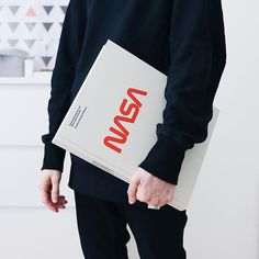 Not sure if the NASA Graphics Standard Manual book is just that big or Im too short compared to it.  Ill leave it up to you to decide in comments  . . . . . #logotype #nasa #space #exploration #manual #graphicdesign #designbook #designers #designcommunity #designspiration #red #typo #allblack #minimalove #holding #graphicsbook #blackstyle #darkstyle #blackforlife #designstudio #stylish
