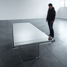 Tokujin Yoshioka to unveil mirrored glass table for Glas Italia in Milan