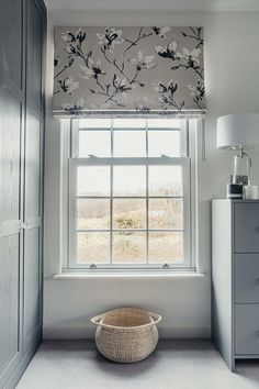 Contemporary bedroom with grey floral Roman blinds in Romo Saphira fabric