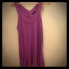 Banana Republic Tank Top. Adorable Banana Republic tank top. Three buttons at top of tank and two front pockets. The top is long and flowy. Size M. Worn once so no tears, stains or defects. Banana Republic Tops