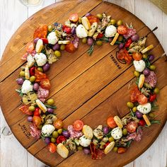 This easy antipasto wreath is great as a simple Christmas appetizer and will add festive flair to all of your holiday parties. More from my siteChristmas Wreath Antipasto Skewers Appetizer Dips, Appetizers For Party, Appetizer Recipes, Easy Christmas Appetizers, Simple Appetizers, Nibbles For Party, Delicious Appetizers, Seafood Appetizers, Cheese Appetizers