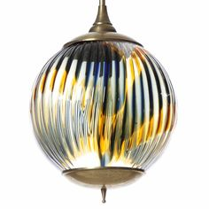 Unique piece of Murano art, surprisingly large circular glass with a wave of blue and yellow colors. The glass globe is ribbed on the outside and holds one light bulb. The picture doesn't really reflect its real beauty.