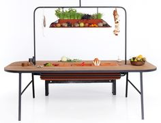 "Philips Eco-Friendly Microbial Home:  ""Larder"" Evaporative Cooler Dining Room Table doubles as a food storage system and evaporative cooler--similar to a natural refrigerator."