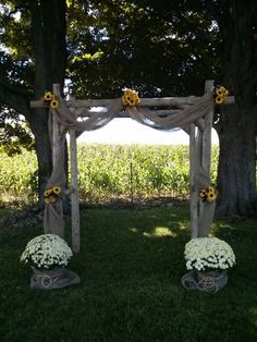 DIY Summer country rustic wedding arch. Sunflower and burlap decor. Made from fence rails. All we used was a chainsaw to notch out the wood and nails to hold it together.