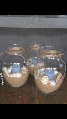 Made my own centerpieces for my beach themed Quinceanera !! Found the shells, candles, and vases all at the dollar tree !
