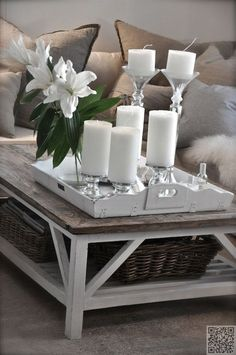Candles in desired color and balanced with flowers. Has to be right from all angles in a room.