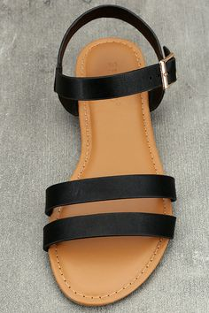 We would walk for miles to get our hands on the Euphrates Black Flat Sandals! Black vegan leather straps create a simple peep-toe silhouette, and quarter strap with adjustable gold buckle at the outstep.