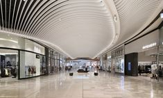 Eastland Shopping Centre lighting design by Electrolight Mall Design, Retail Design, Shoping Mall, Shopping Mall Interior, Wood Ceilings, Ceiling Design, Ceiling Ideas, Shop Interior Design, Shopping Center