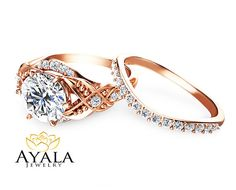 Big, bold and brilliant are words that best describe this alluring 14K rose gold leaf engagement ring set. Custom handmade by a seasoned jewelry-smith, it features a unique woven band that is encrusted with sparkling diamond accents. The large 2ct forever brilliant moissanite is a showstopper and will render her speechless as you pop that question! This leaf engagement ring set also includes a diamond encrusted matching band that fits within the design for a seamless look when worn. A This…