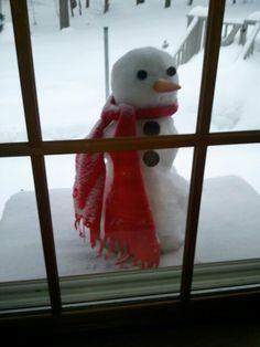 Who's that snowman peeking in my window?