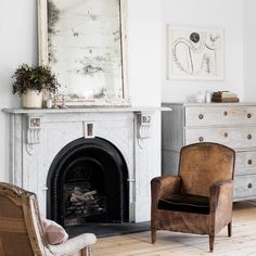 The antique mirror, armchairs and chest all show signs of genteel weathering and form a dreamy tableau against the marble fireplace.  Photo: Martina Gemmola Stylist: Ali Ross Australian House & Garden February 2017
