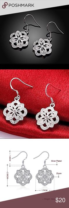 🌼Silver Plated Cubic Zirconia Flower Earrings NWT Silver Plated Cubic Zirconia Flower Earrings NWT:  Gorgeous silver-plated earrings with embedded cubic zirconia for that extra sparkle! Jewelry Earrings