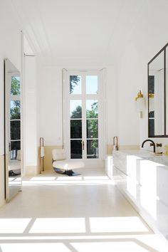 A Private Apartment by Joseph Dirand In Saint-Germain-des-Prés, Paris, France: The lounge chair by Oscar Niemeyer, 1978.
