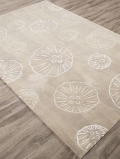 A unique pattern of scattered mystical jellyfish images creates the design on this new neutral under-the-sea rug, offering an updated, luxurious beach house feel.
