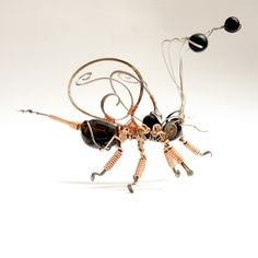 bee wire sculpture stainless steel aluminium natural seeds by raizesimaginarias