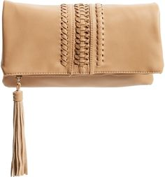 Huarache weaving and a tasseled zip pull add extra hints of vintage intrigue to this faux-leather fold-over clutch.