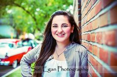 Fun, fresh, cityscape, on location Rochester, NY High School Senior photography , brunette female teen, red brick wall, red convertible, historic neighborhood http://www.seganphoto.com/portfolio_seniors.html