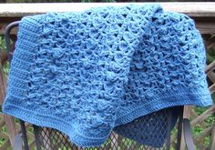 butterfly lace blanket , This lacy throw looks classy in a solid color, but can be made with stripes. The example is made in worsted weight acrylic yarn.