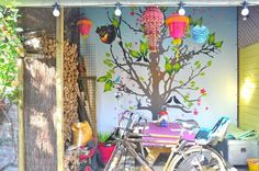 """""""happy"""" outdoor space. Love the tree mural."""