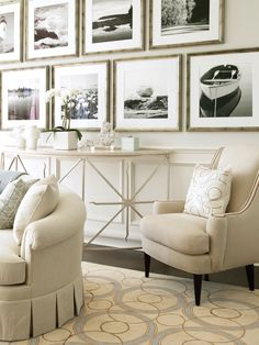 black and white gallery wall and soft neutral furnishings