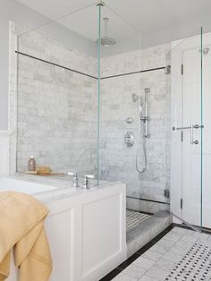 Master Bathroom - Glass shower w/ Stone Tile.   Keep it light to make room look larger!