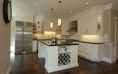 White cabinets dark wood floors