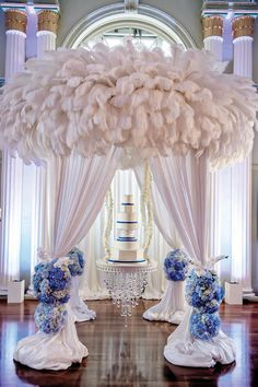 blue and silver wedding reception-silver bling wedding-wedding-white feathers-biltmore wedding-hanging cake